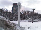 A lamppost by the falls encrusted in ice